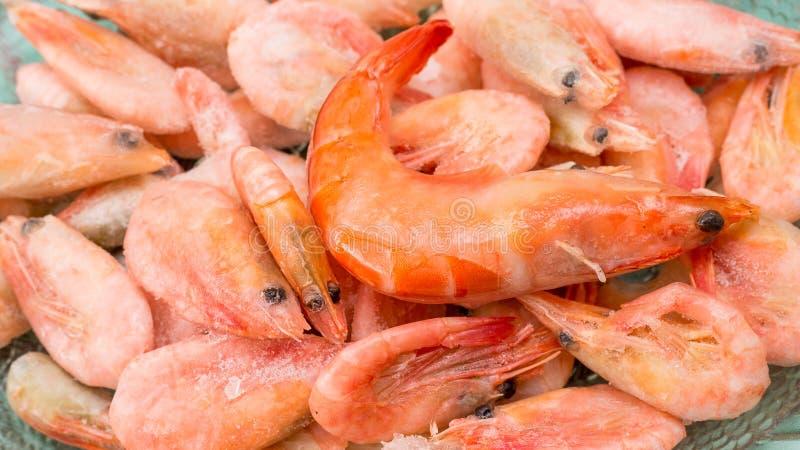 Frozen orange shrimp close-up of a horizontal frame. stock photography
