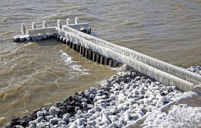 Frozen pier in Afsluitdijk. Major causeway in Netherlands royalty free stock photos