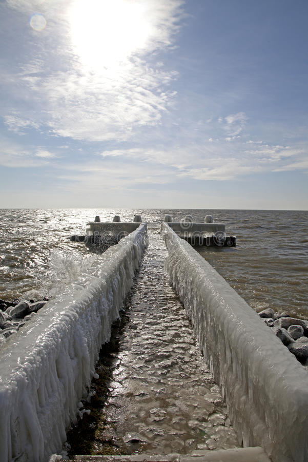 Frozen pier in Afsluitdijk. Major causeway in Netherlands royalty free stock photo