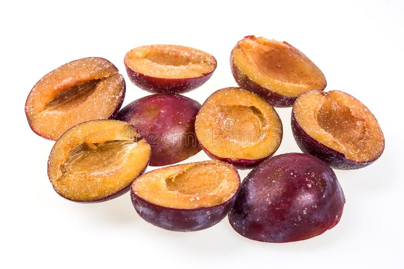 Frozen plum without pit.Macro,frozen organic plum,a handful of s stock photography