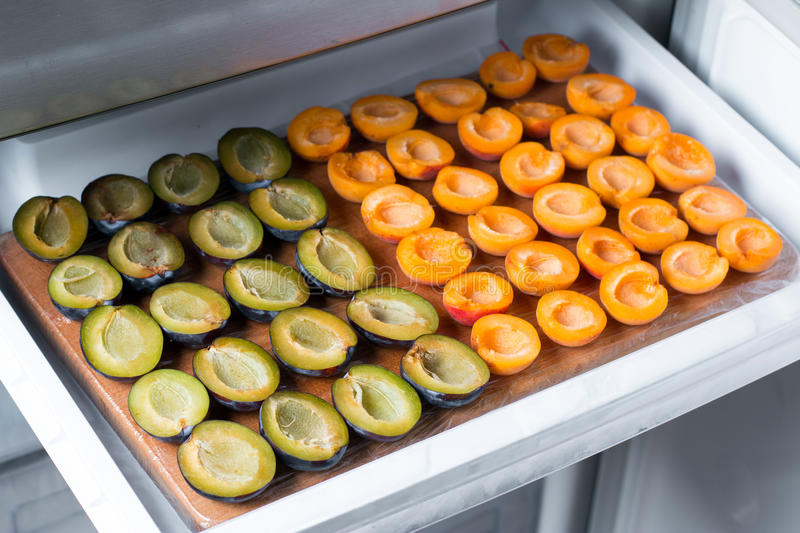 Frozen plums and apricots. In the freezer stock photography