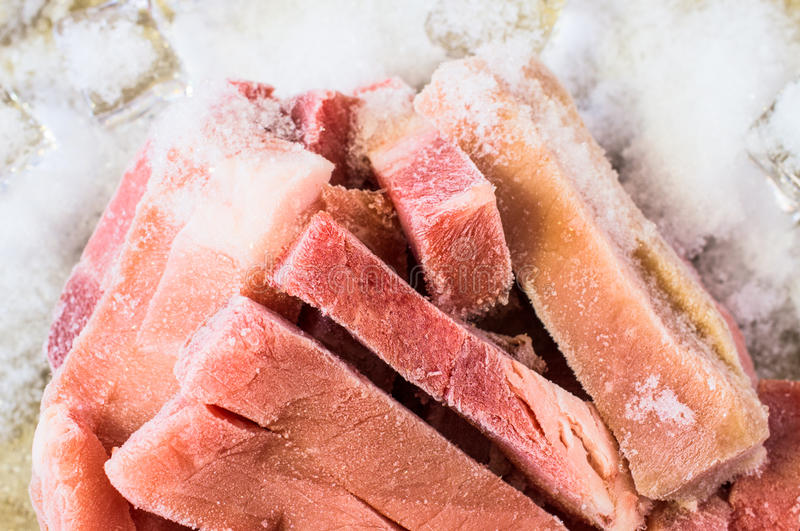 Frozen pork. Frozen meat pork slices with hoarfrost royalty free stock images