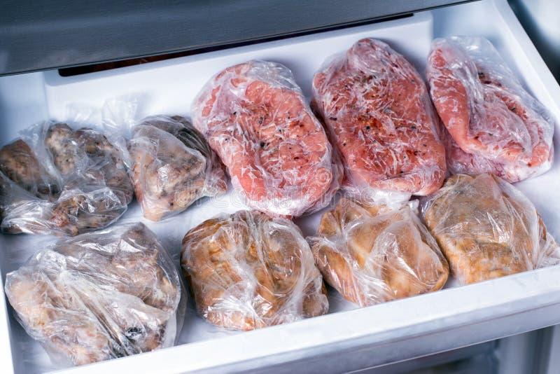 Frozen pork neck chops meat steakin the freezer. Frozen food stock photography