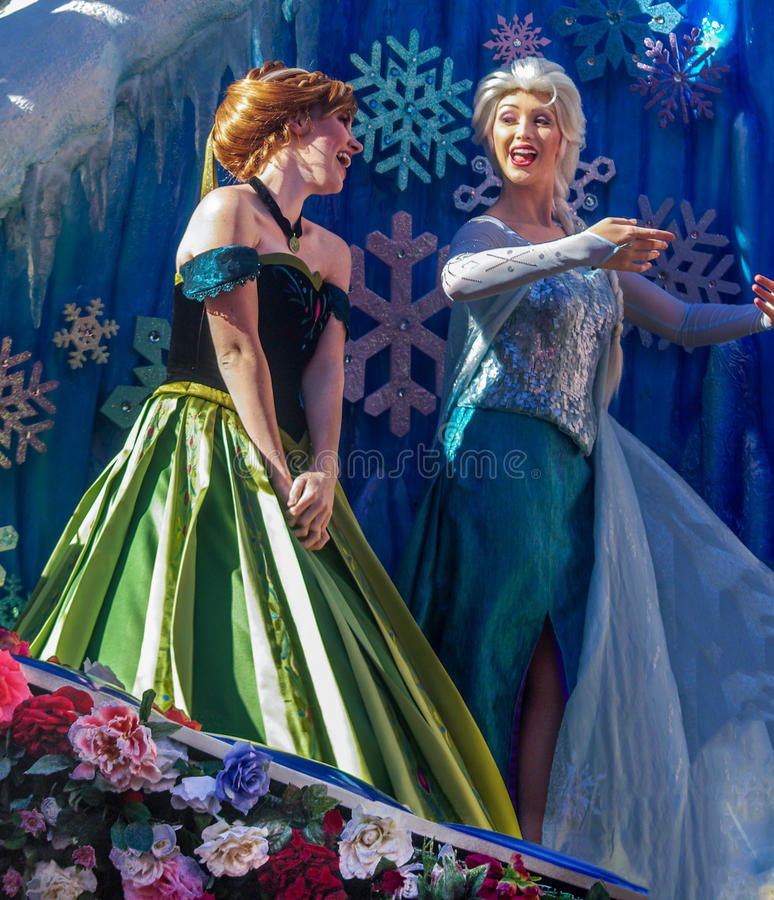 Frozen Princesses, Elsa and Anna, in the Walt Disney World Parade. The ever popular Elsa and Anna Princesses in the Walt Disney World, Magic Kingdom 3pm Parade stock image