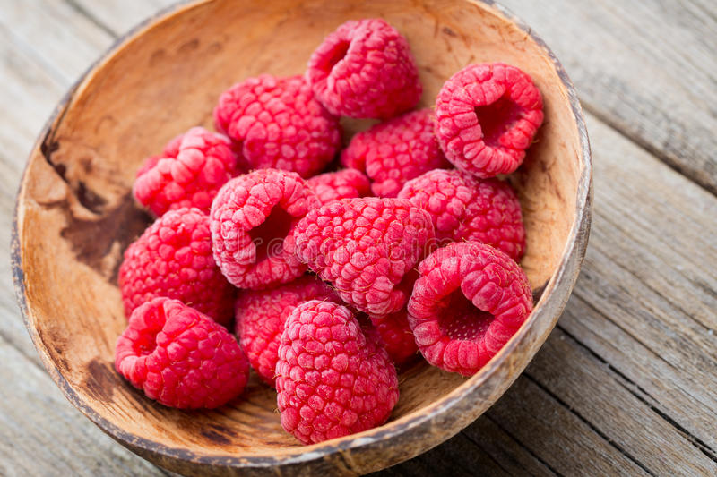 Frozen raspberries on wooden background royalty free stock image