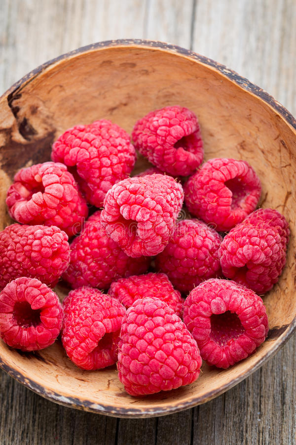 Frozen raspberries on wooden background. royalty free stock photography