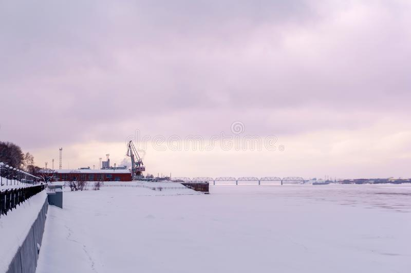 Frozen river, cargo port and quay royalty free stock image
