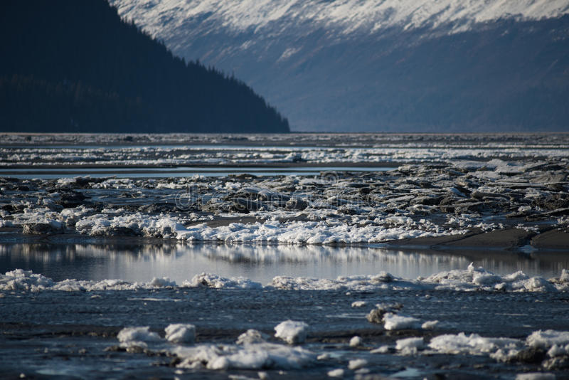 Frozen river ice flow. Frozen river with ice flow in mountains. alaska usa stock images