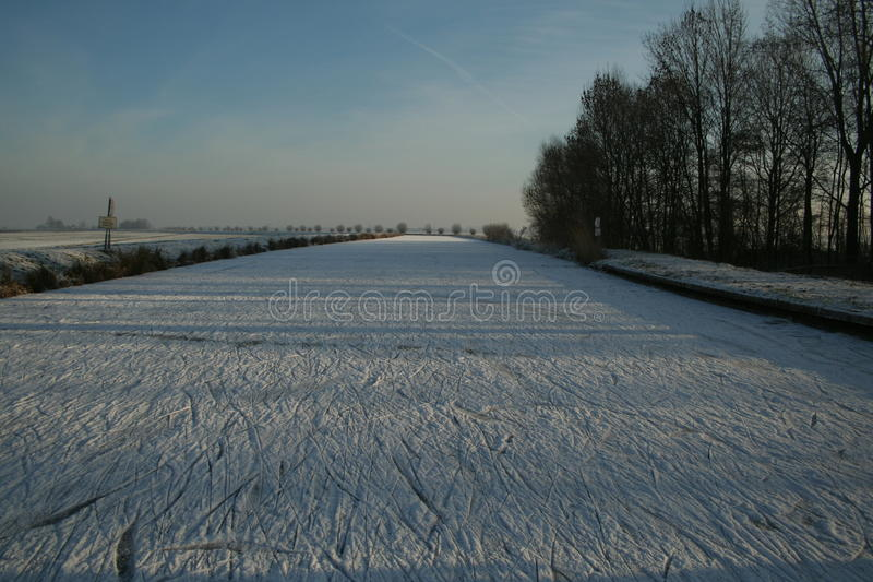Frozen river. Iceskating on a frozen river in The Netherlands royalty free stock photos