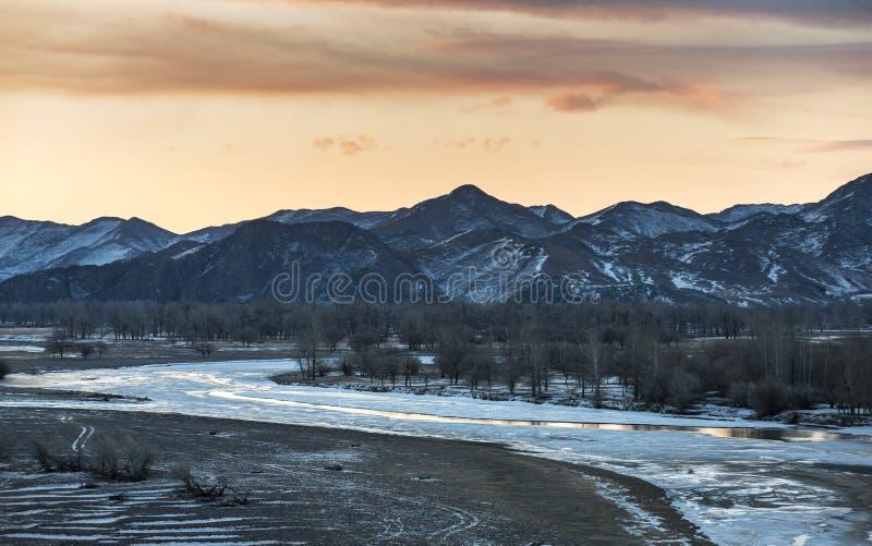 Frozen river in Mongolian winter landscape royalty free stock photography