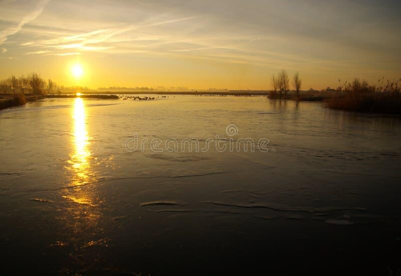 Frozen river at sunrise stock photos