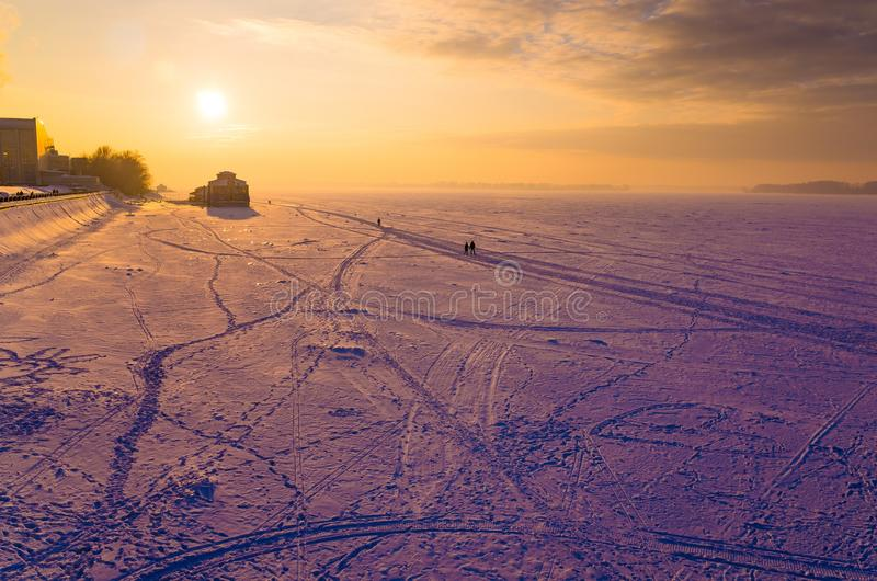 A frozen river at Valentine's Day during Sunset stock images