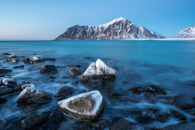Frozen rocks on Skagsanden beach in Lofoten Norway stock photos