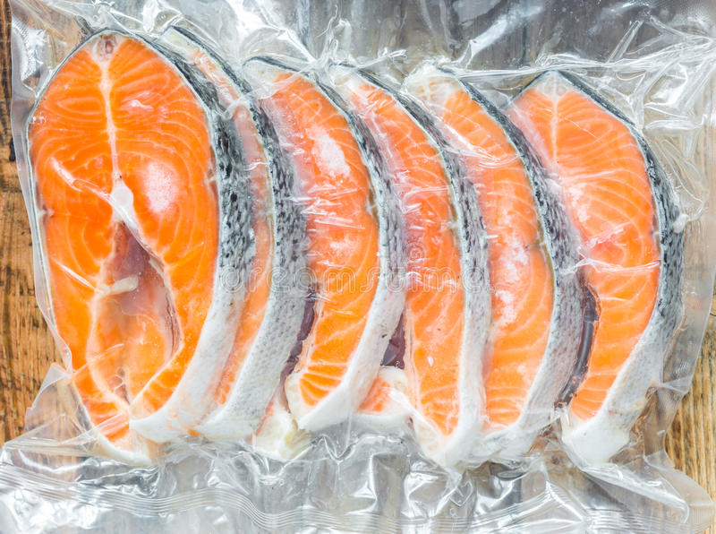 Frozen salmon fillets stock image