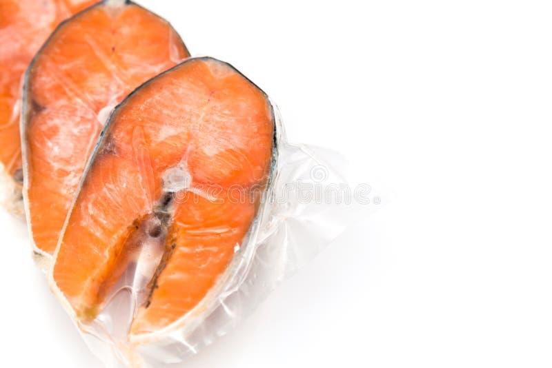 Frozen salmon fillets stock images