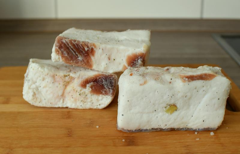 Frozen, salted pork lard with garlic and pepper. royalty free stock photo