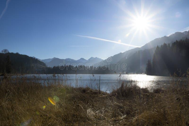 Frozen Schwarzsee, Kitzbühel with sunlight. Tirol, Austria royalty free stock image