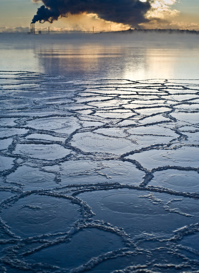 Frozen sea ice with pollution in background