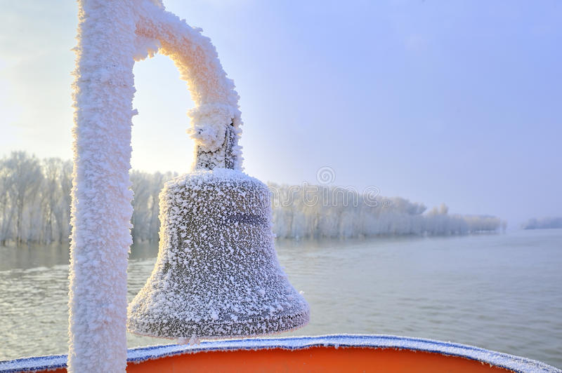 Frozen ship bell in winter time. Frozen ship bell detail in winter time royalty free stock photos