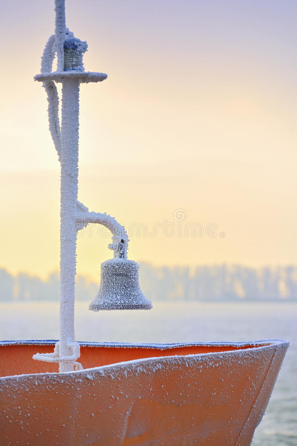 Frozen ship bell. In winter time royalty free stock photography