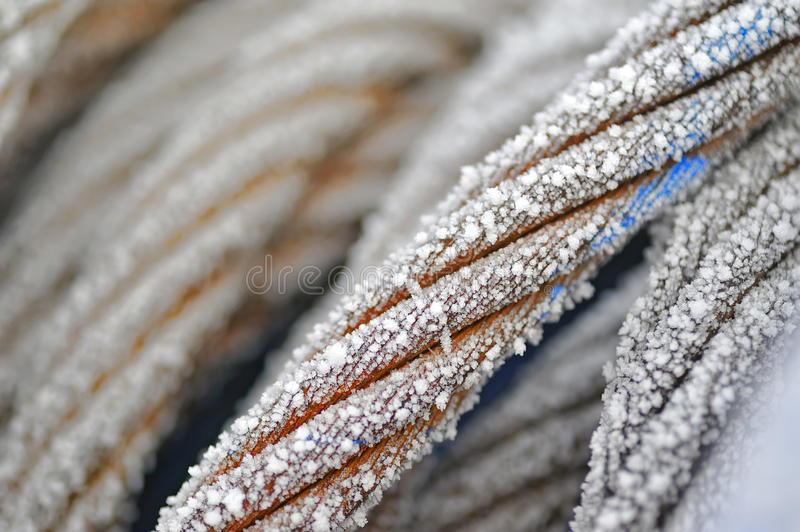 Frozen ship cable. In winter time royalty free stock photography