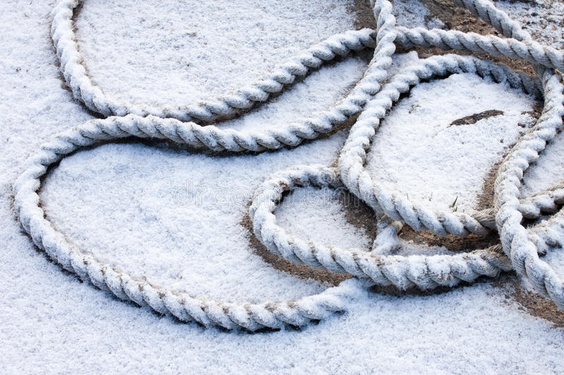 Frozen ship cable. Under snow royalty free stock image