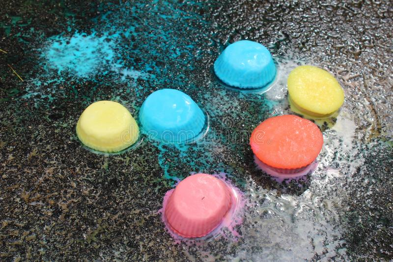 Frozen sidewalk paint preparation and use in a daycare/home school setting.  stock photography