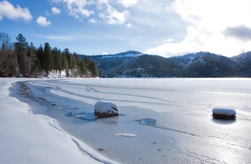 Frozen Spirit Lake in Idaho. Frozen Spirit Lake shore line during winter in Spirit Lake, Idaho stock images