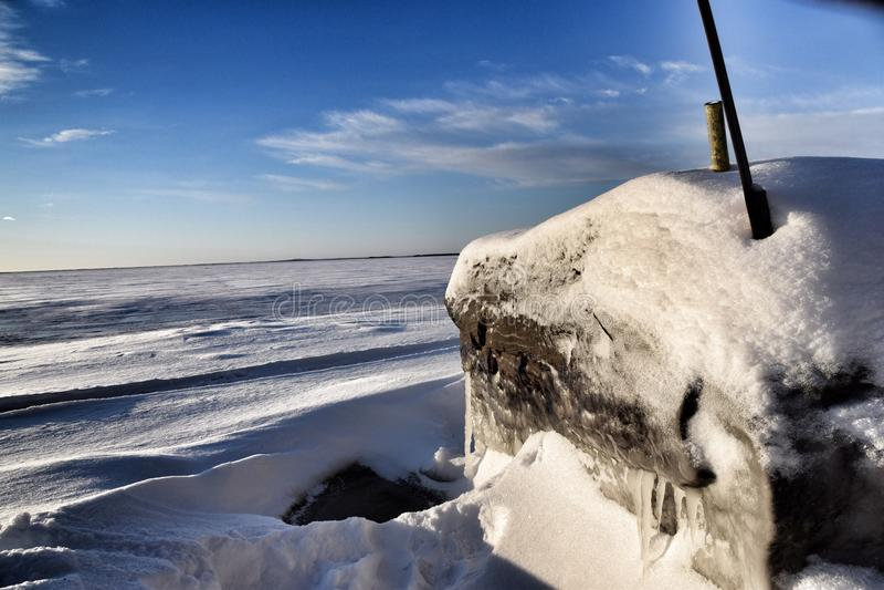 Frozen stone on the beach royalty free stock photos