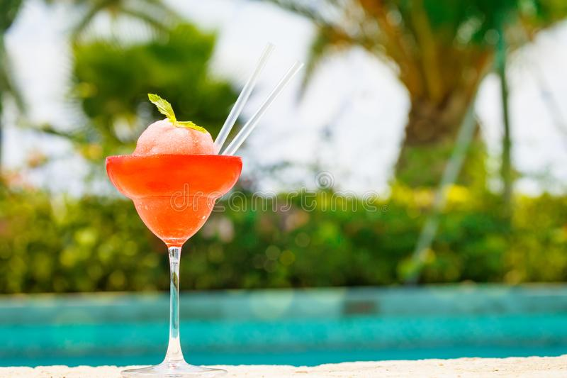 Frozen strawberry margarita cocktail at the edge of a resort poo stock image