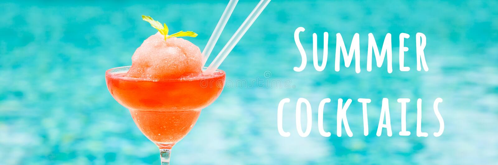 Frozen strawberry margarita cocktail at the edge of a resort pool. Concept of luxury vacation. Summer cocktails wording. Frozen strawberry margarita cocktail at stock images