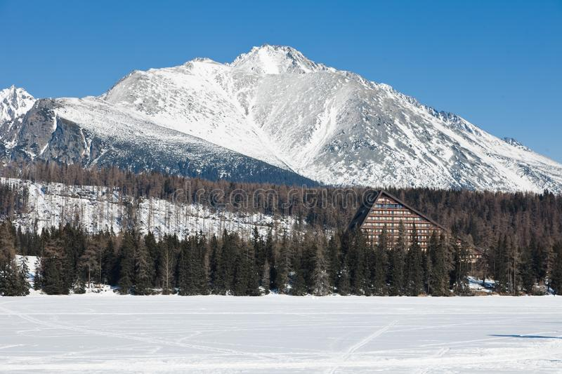 Frozen surface of lake in mountains stock photos