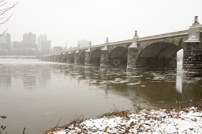 Skyline and Market Street bridge over Susquehanna River in Harrisburg, PA in snow stock photography