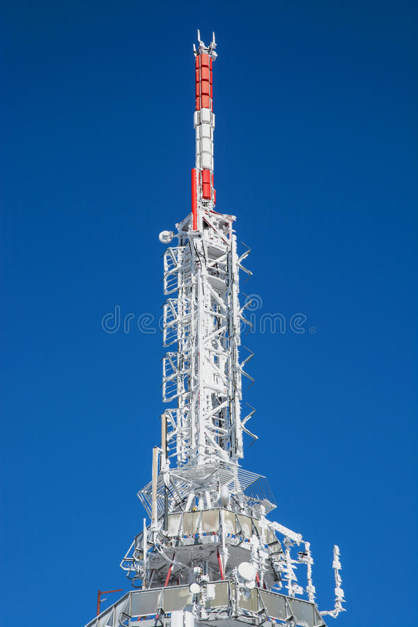 Frozen telecommunication tower. On the Zobor hill near Nitra city in winter royalty free stock images