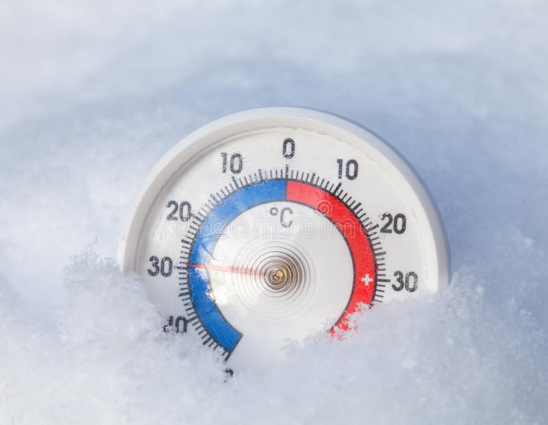 Frozen thermometer shows minus 29 Celsius degree extreme cold wi stock image