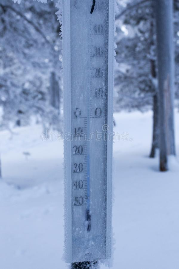 Frozen thermometer during polar night in Finland. Temperature far below zero royalty free stock images