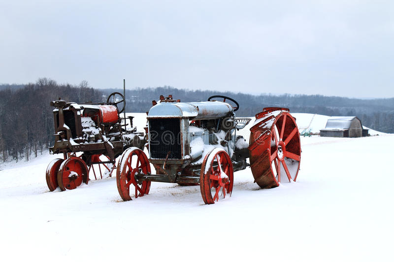 Frozen Tractors. Two antique tractors on a cold, snowy, West Virginia winter day stock photos