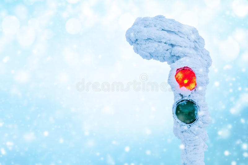 Frozen traffic lights with red light lit. Free space for text stock photo