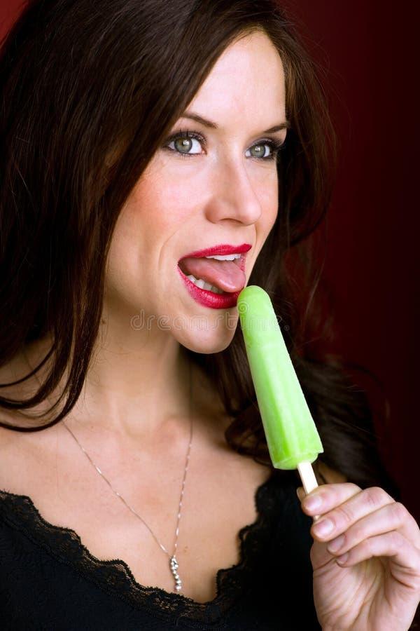 Woman Holds Frozen Green Ice Cream treat royalty free stock photos