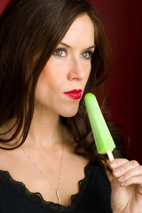Woman Vertical Holds Frozen Green Sweet Treat stock photography