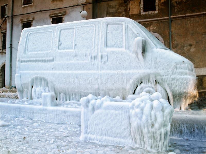 Frozen van. Icebound van due to strong wind, splash of sea and very low temperatures royalty free stock photo