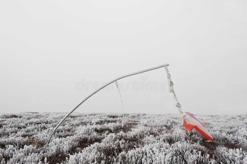 Frozen vane. Indicator of wind direction and flow forces at mountain.  stock photos