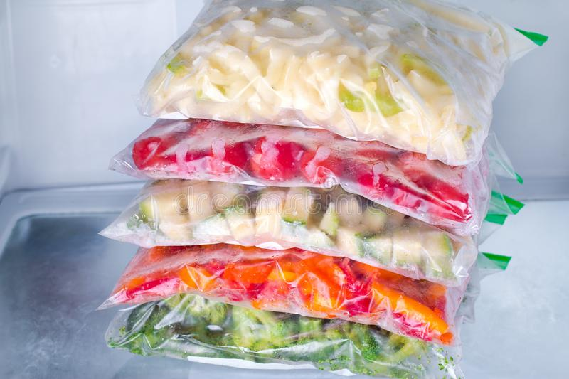 Frozen vegetables in bags in refrigerator. Freezing. stock photography