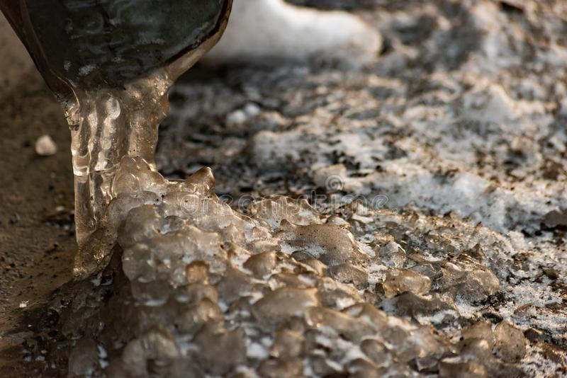 Frozen water from the drain pipe. Is close royalty free stock photos