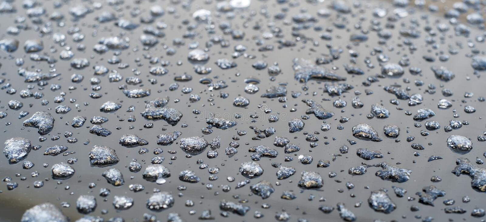 Frozen water drops. On a roof of a car royalty free stock images