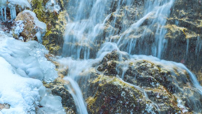 Frozen water fall in the bavarian alps mountains. Frozen water fall bavarian alps mountains royalty free stock photo