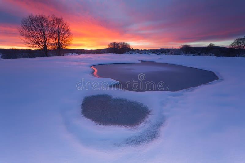 Download Frozen water stock photo. Image of frozen, sunrise, orange - 66911796