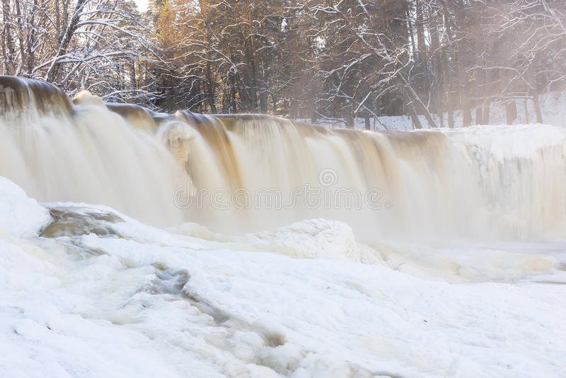 Frozen waterfall in Estonia stock images