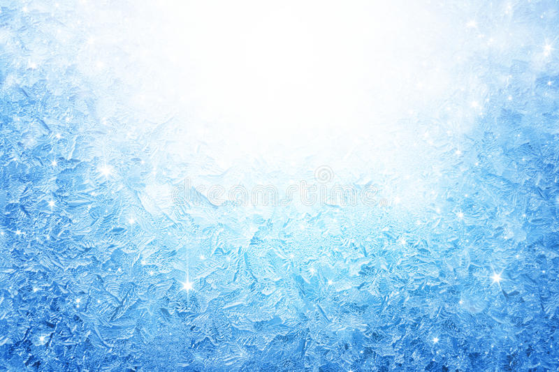 Frozen window. Abstract winter background - blue frozen window with bright light and stars