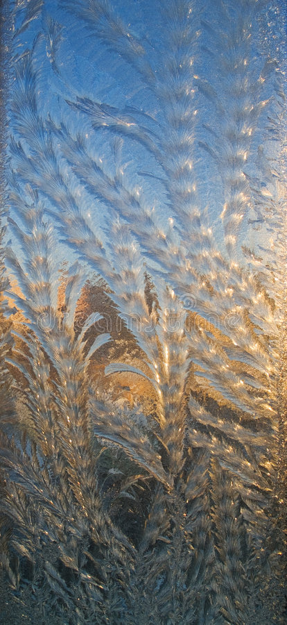 Frozen window and sunset stock photography